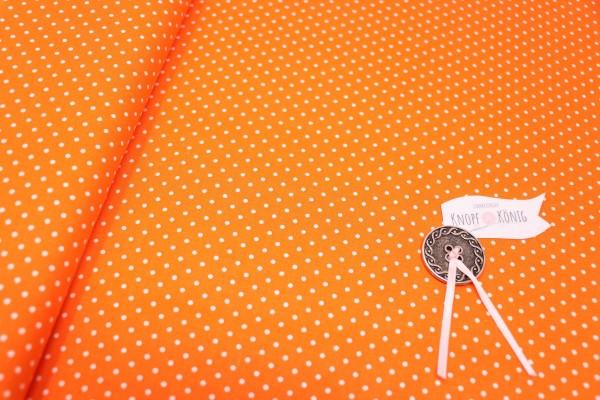 Oranger Baumwollstoff mit weißen Punkten