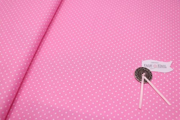 Rosa Baumwollstoff mit weißen Punkten