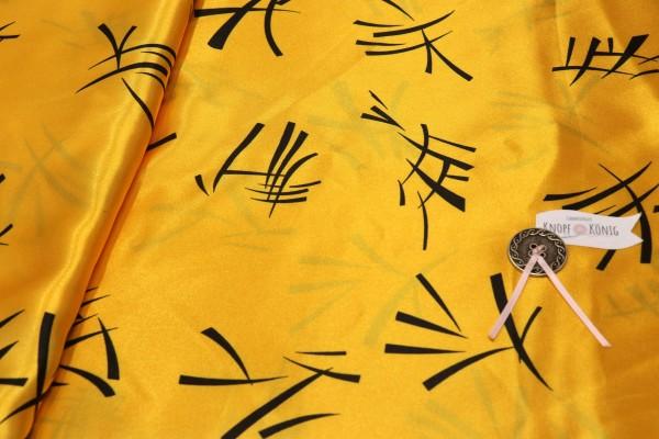 Faschingsstoff, gelb mit chinesischen Zeichen