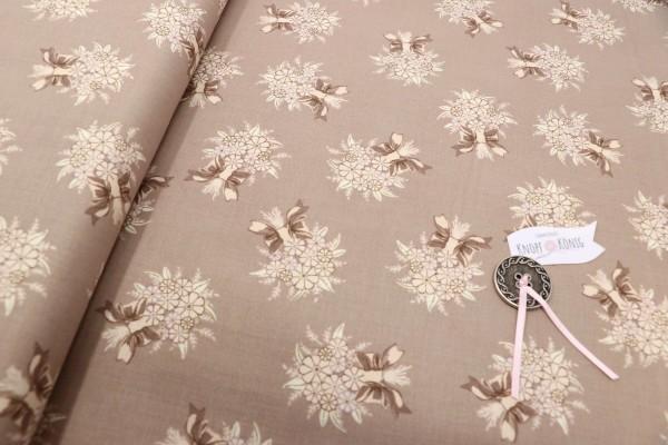 Brauner Baumwollstoff mit floralem Muster