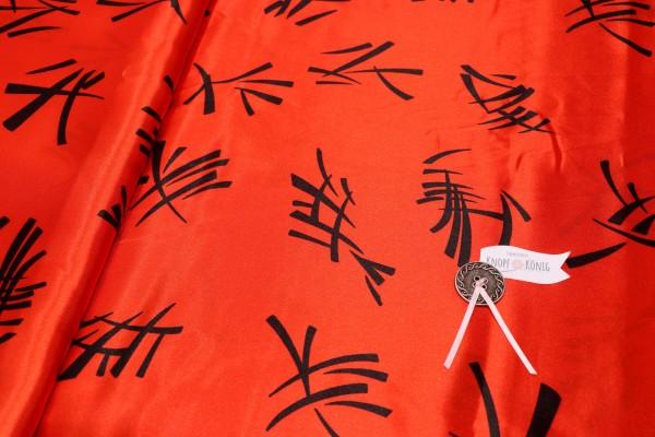 Faschingsstoff, hellrot mit chinesischen Zeichen