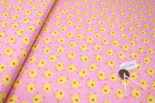 Rosa Baumwollstoff mit gelben Küken